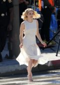 Emma Roberts spotted in a white silk dress while filming a new Hugo Boss Women's Campaign in Downtown Los Angeles