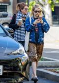 Emma Roberts wore a leopard print skirt and blue jacket while out with her mother Kelly Cunningham in Los Angeles