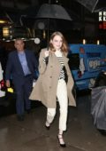 Emma Stone rocks a trench coat with a pair of stylish Louis Vuitton heels as she arrives for a screening in New York City