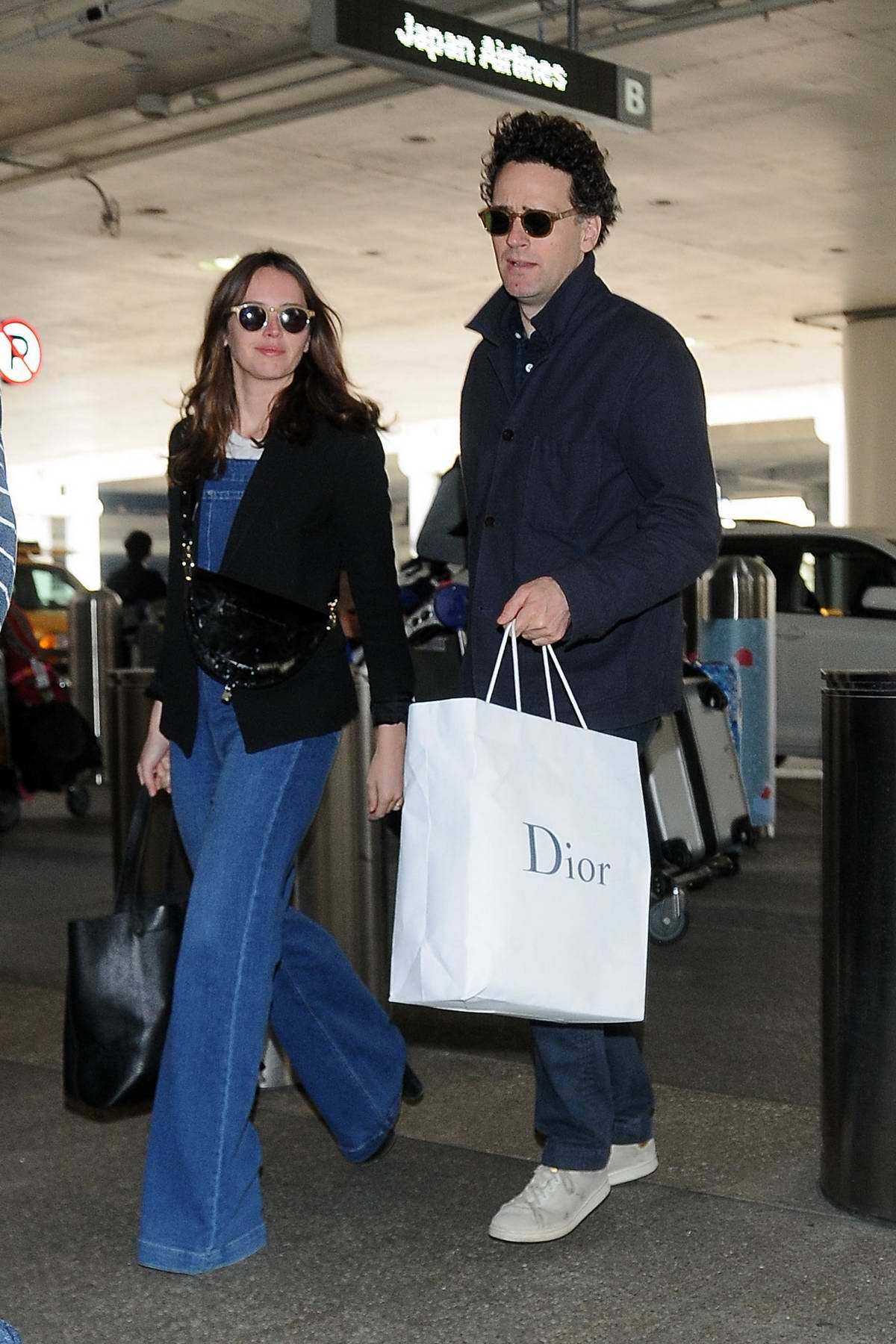 Felicity Jones and husband Charles Guard spotted at LAX airport in Los Angeles