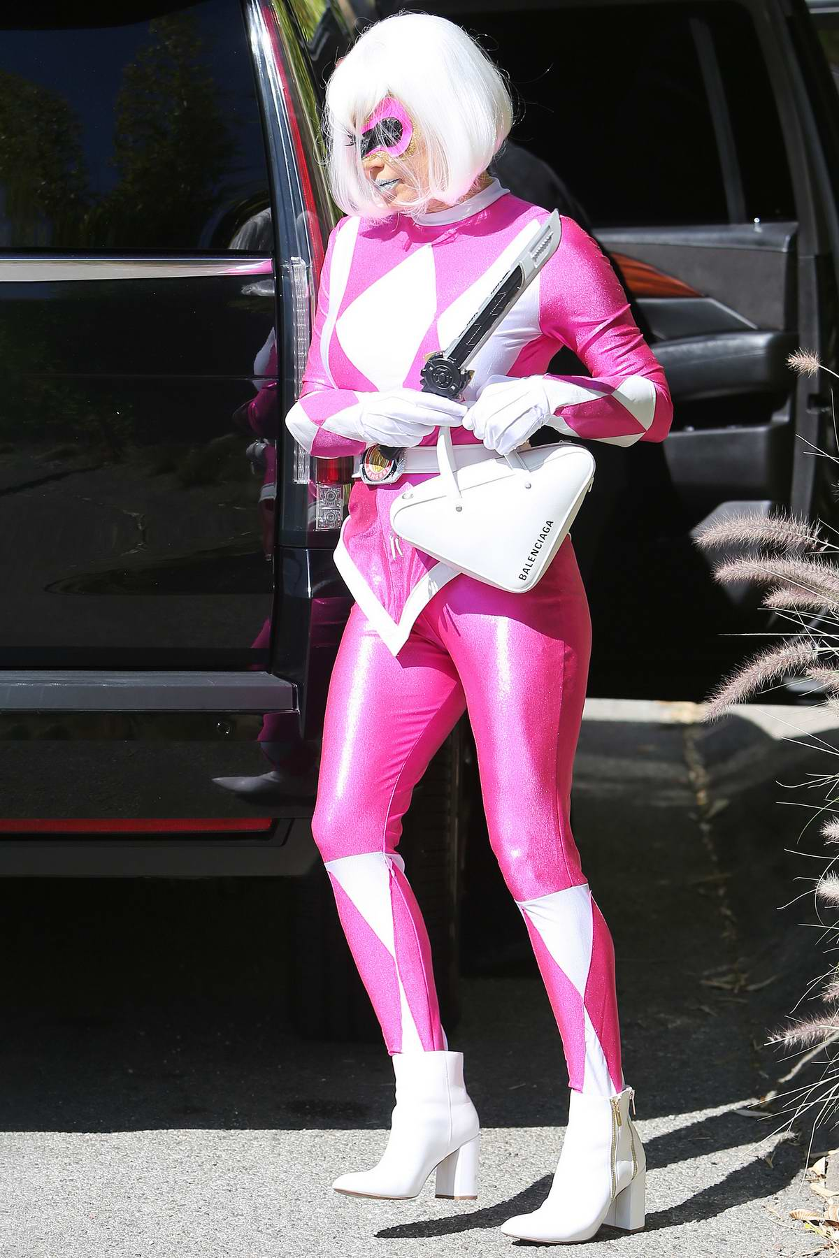 Fergie dresses up as pink Power Ranger on Halloween as she leaves her house in Santa Monica, California