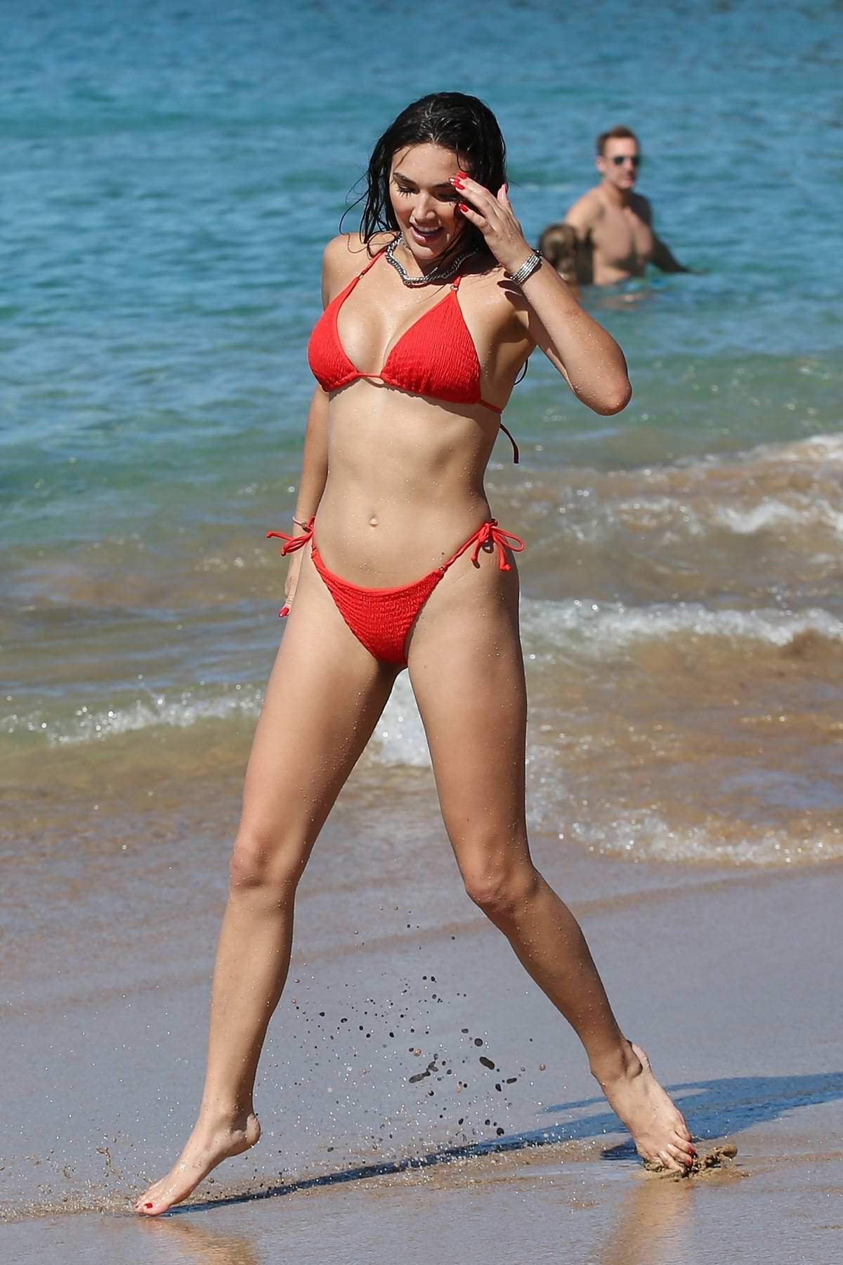 Hailee Lautenbach sizzles in a red bikini during a beach outing in Maui, Hawaii