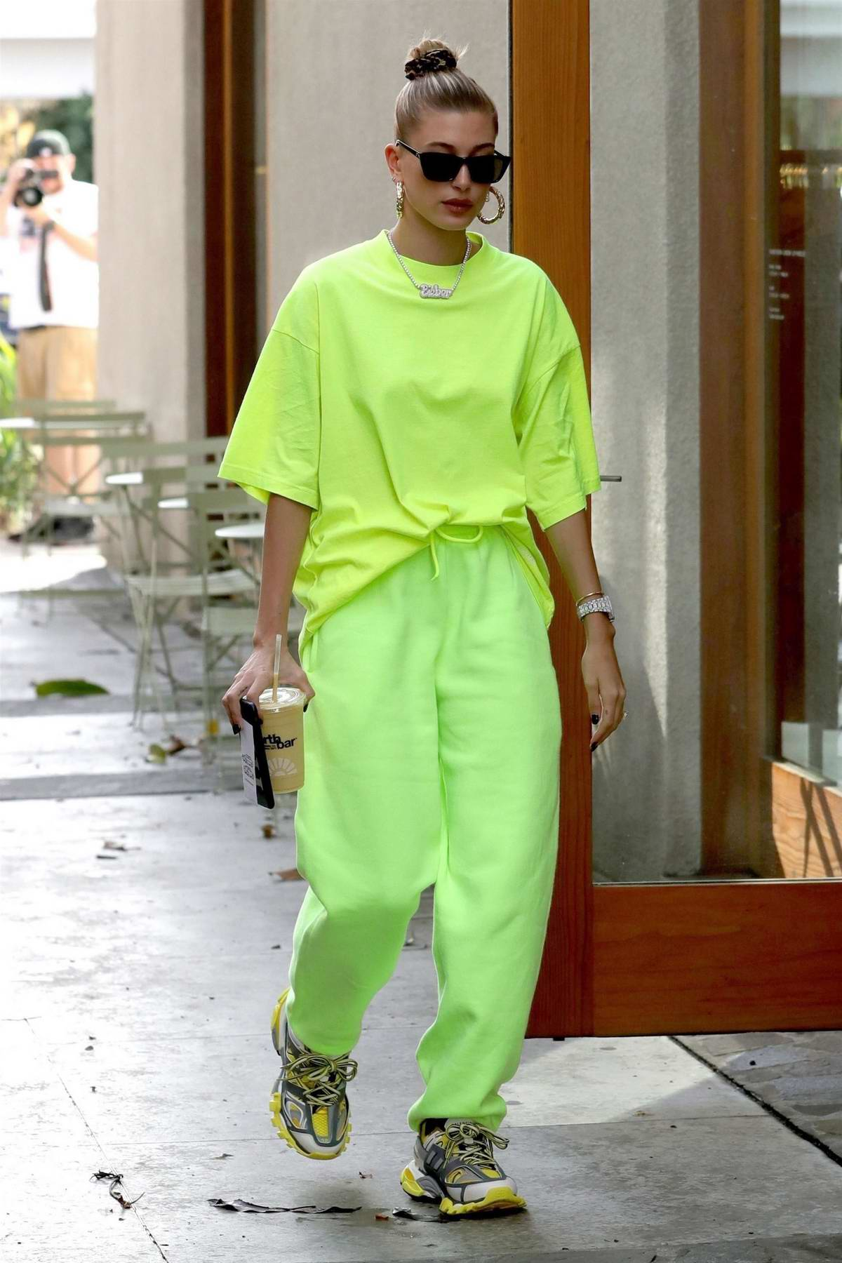 Hailey Baldwin rocks neon green outfit with a Bieber necklace as she arrives at Nine Zero One salon in West Hollywood, Los Angeles