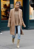 Hailey Baldwin steps out in a peach long coat with matching turtleneck sweater in New York City