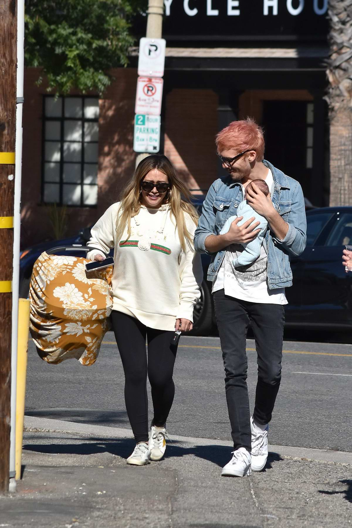 Hilary Duff and Matthew Koma cradles their newborn daughter as they leave after lunch at Joan's on Third in Studio City, Los Angeles