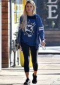 Holly Madison wears a NCLA sweatshirt and black leggings while out in Los Angeles