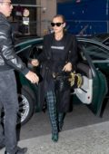 Irina Shayk wore a black trench coat as she arrives at the Regent Hotel in Berlin, Germany