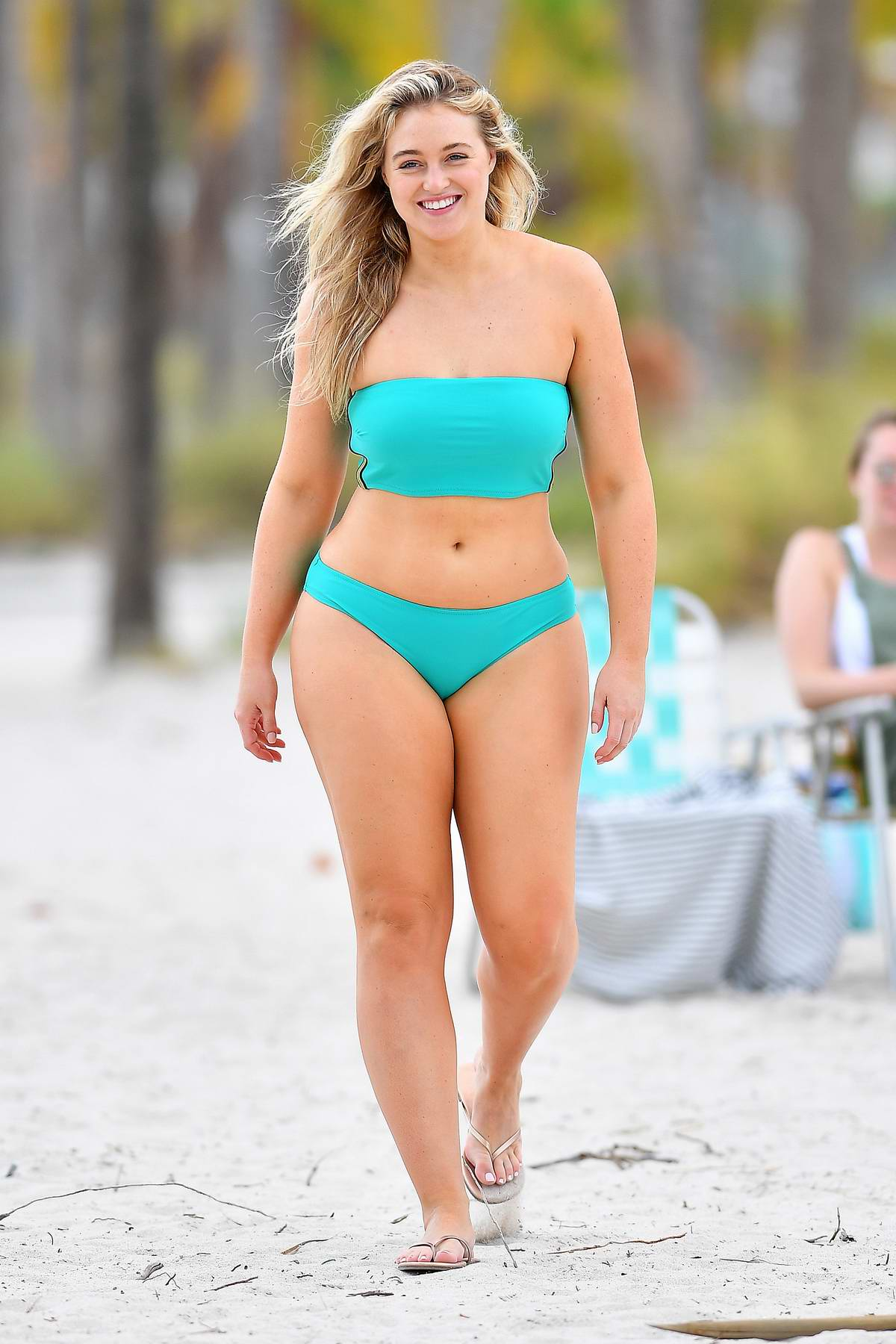 Iskra Lawrence rocks teal bikini and swimsuit during a beach photoshoot for Aerie in Key Biscayne, Florida - Day 2 - Set 02