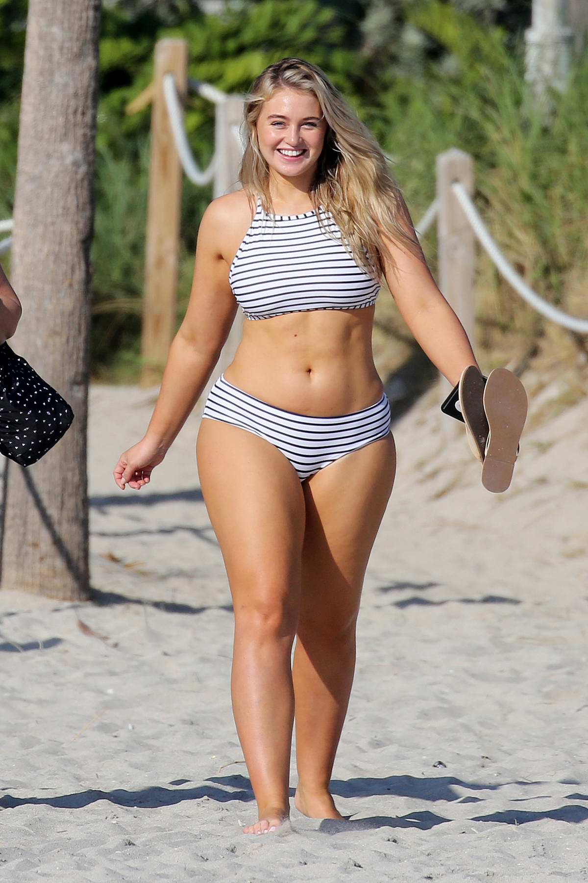 Iskra Lawrence wears a striped bikini during a beach photo shoot for Aerie in Miami Beach, Florida - Set 05