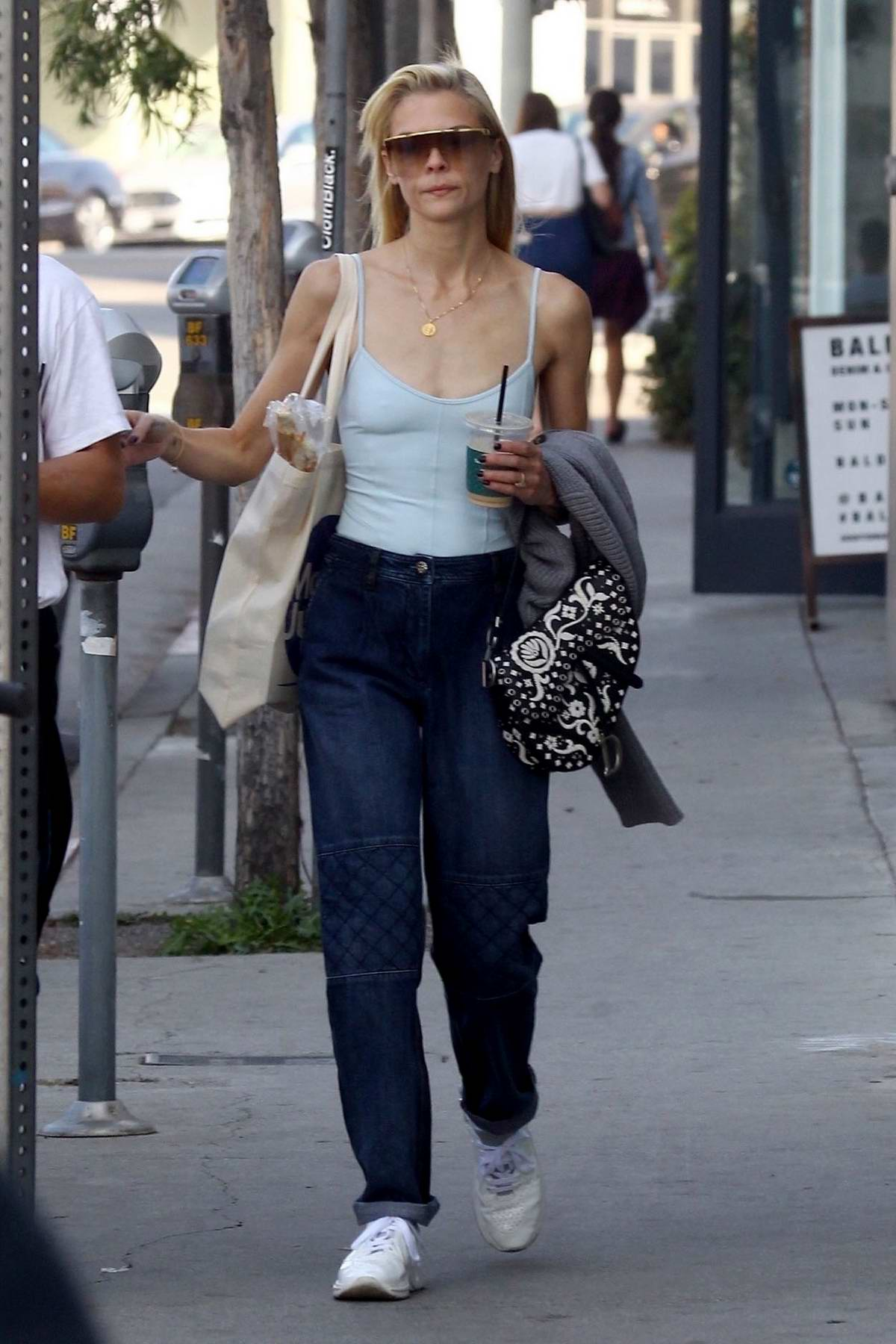 Jaime King steps out in a blue top and jeans while running errands in West Hollywood, Los Angeles