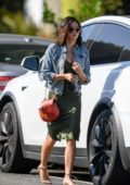 Jenna Dewan wears a green silk dress with denim jacket while visiting a friend in Santa Monica, California