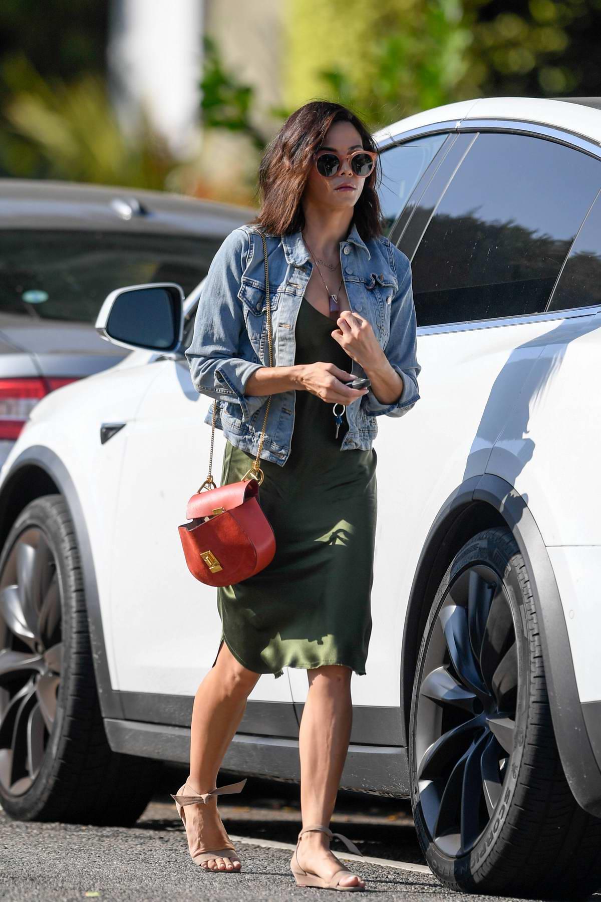 Jenna Dewan wears a green silk dress with denim jacket while visiting a friend in Santa Monica, California