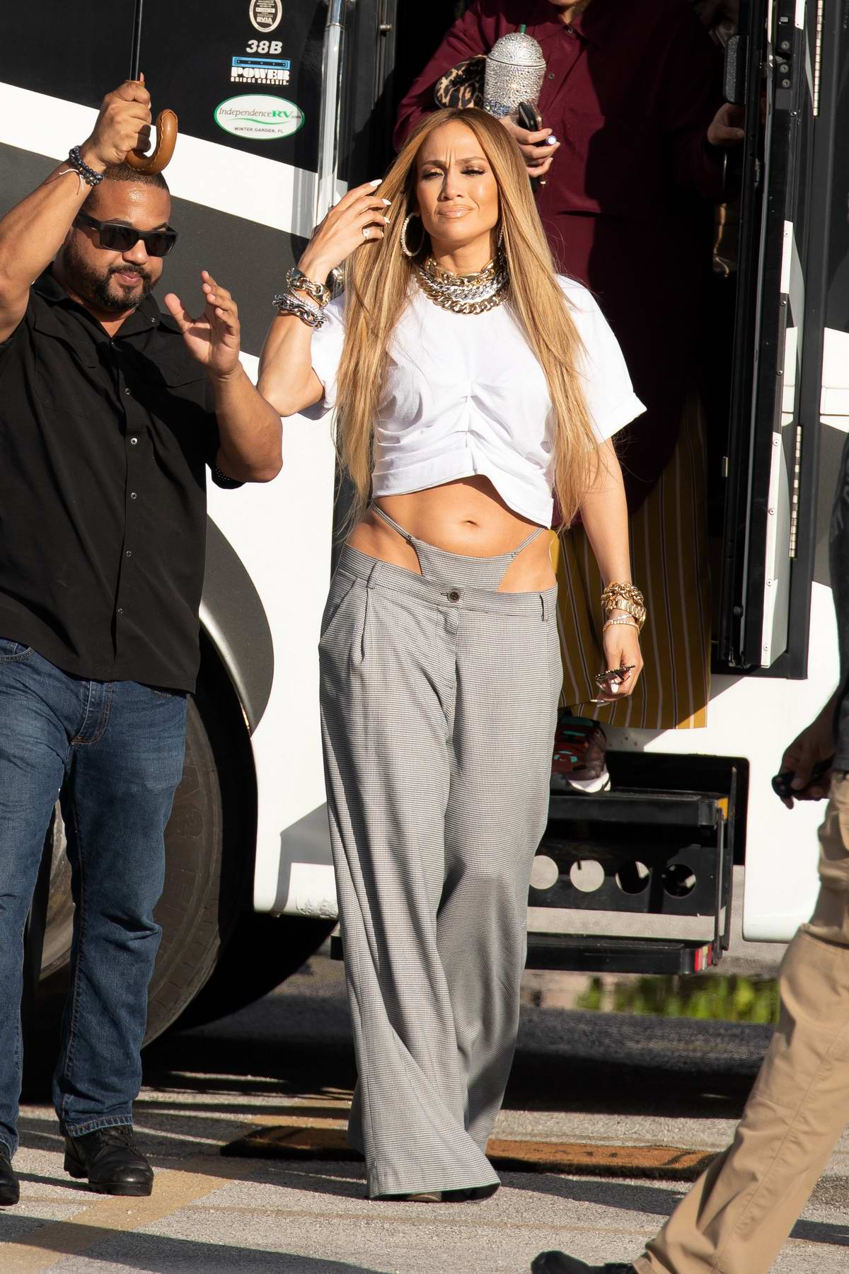 Jennifer Lopez flaunts her toned midriff in a crop top and low hung pants while on the set of a video shoot with DJ Khaled in Miami, Florida