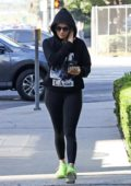 Jennifer lopez seen wearing a black hoodie and black leggings with a pair of neon green trainers while heading to the gym in Los Angeles