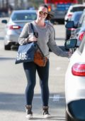Jennifer Love Hewitt smiles for the camera as she leaves the gym in Los Angeles