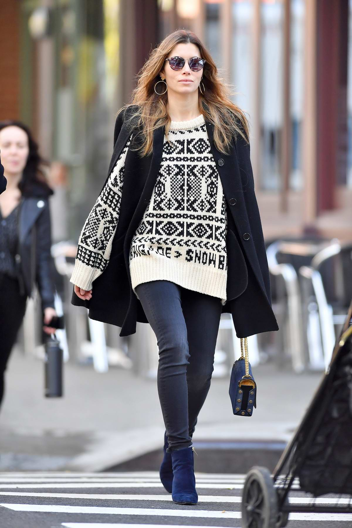 Jessica Biel wears a patterned beige sweater and skinny jeans while out in New York City