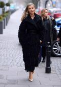 Joanna Krupa seen wearing a long black coat as she steps out on a chilly day in Warsaw, Poland