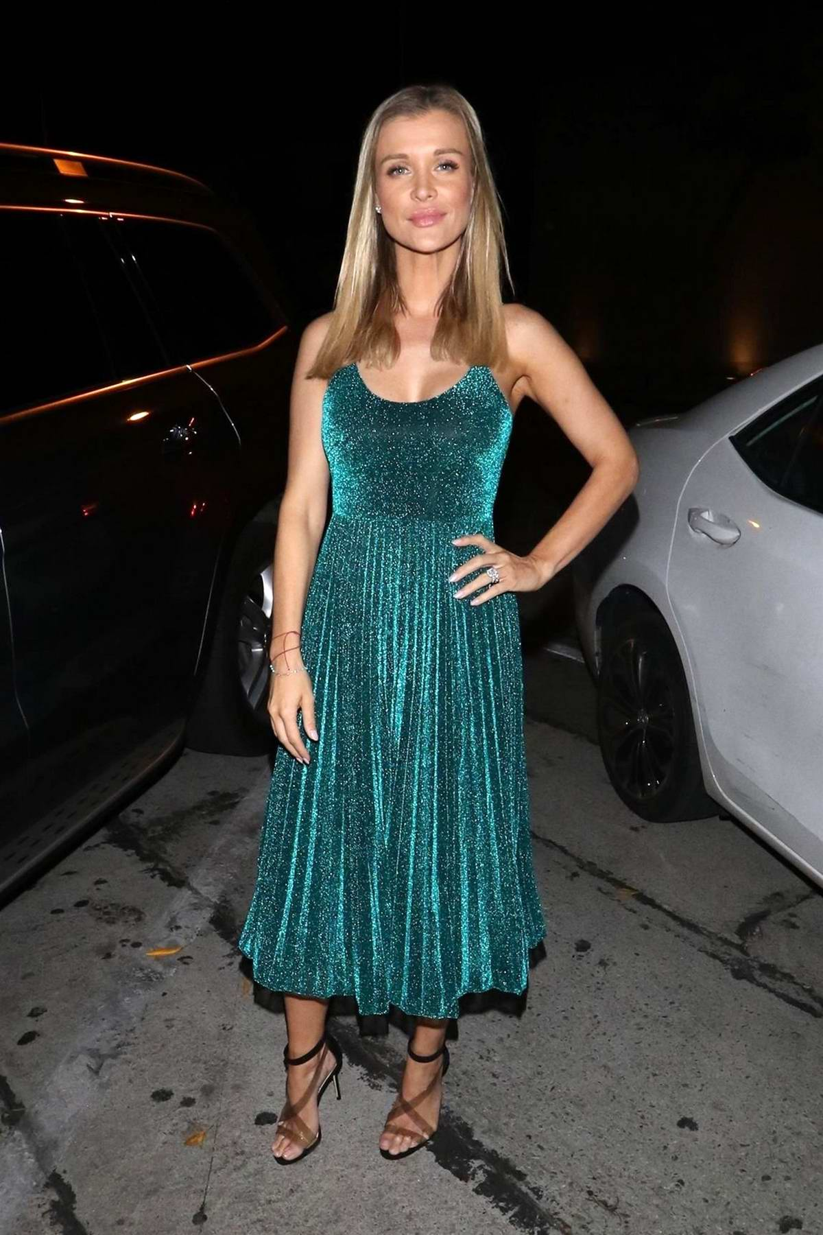 Joanna Krupa stops for photos as she leaves Craig's restaurant in West Hollywood, Los Angeles