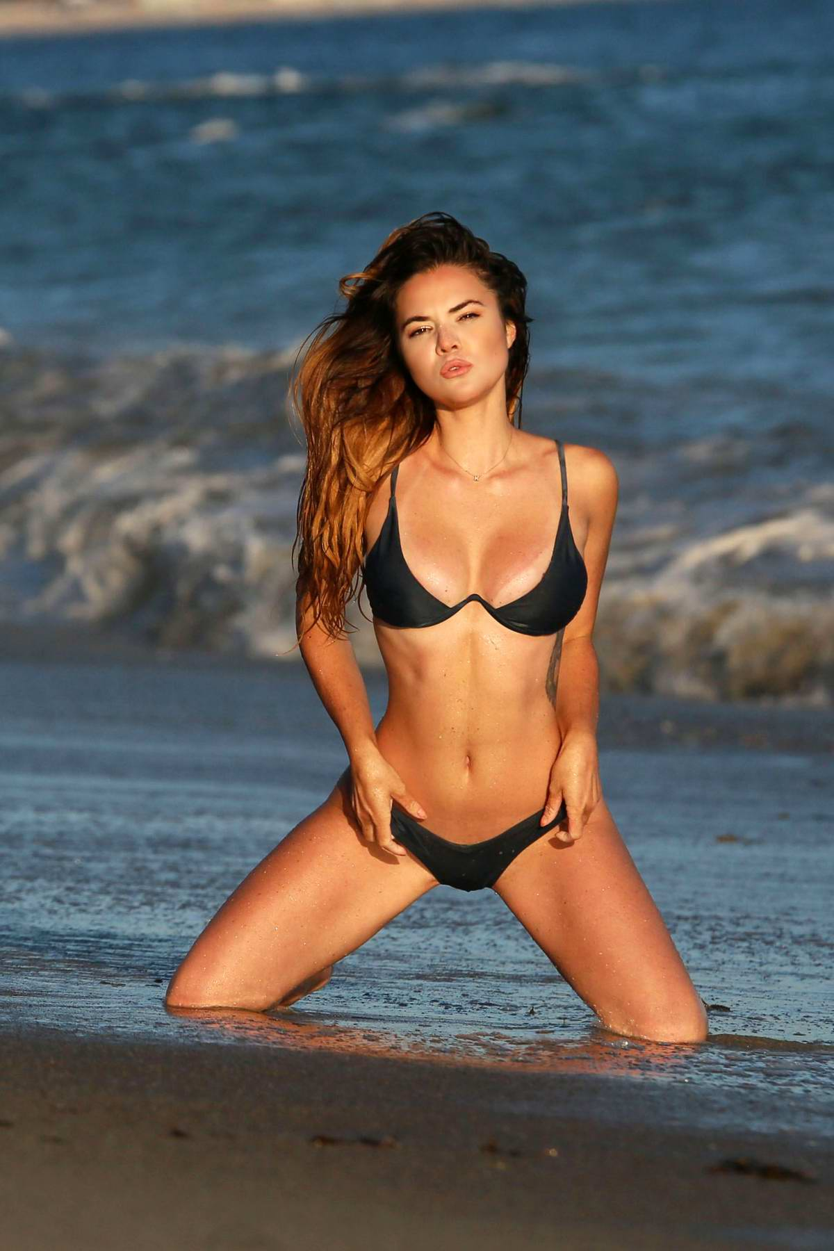 Kaili Thorne poses in a bikini during a beach photoshoot for 138 Water in Santa Monica, California