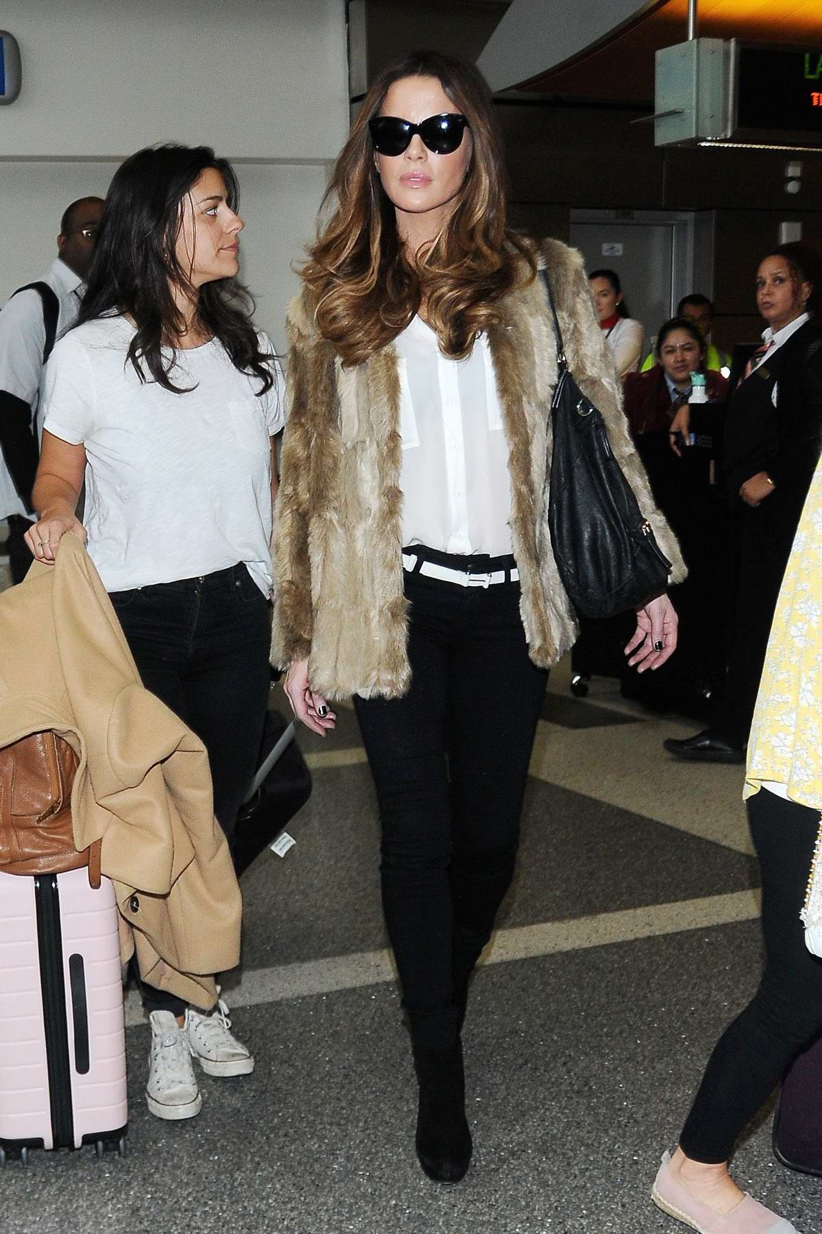 Kate Beckinsale looks stunning in a fur jacket, white shirt and black skinny jeans with matching heels as she arrives at LAX airport in Los Angeles