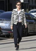 Kate Mara wore a black and white striped cardigan over a white top while out shopping on Melrose Avenue in Los Angeles