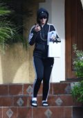 Katy Perry goes incognito with an Adidas sweatsuit as she leaves a friends house in Los Angeles