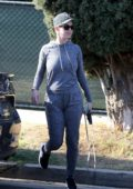 Katy Perry spotted in grey sweats as she steps out for coffee with her dog in Los Angeles