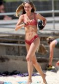 Kendal Lee Schuler seen wearing a red bikini as she enjoys a beach day in Bondi, Sydney, Australia