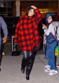 Kendall Jenner spotted in a red and black plaid shirt and leather pants while visiting Victoria's Secret offices in New York City