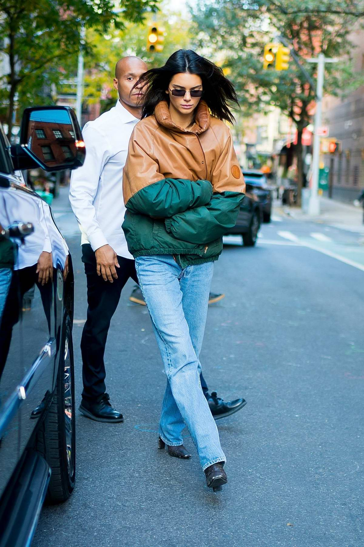 Kendall Jenner steps out wearing a bicolored windbreaker for her morning coffee in SoHo, New York City