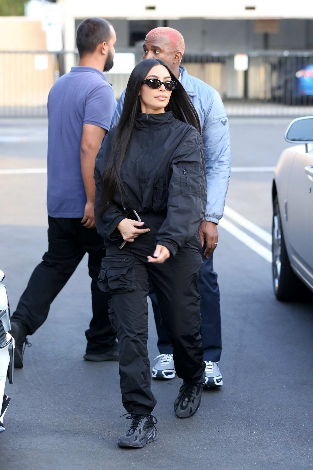 Kim Kardashian dons all black as she arrives at XIV Karats jewelry store with Kanye West in Los Angeles