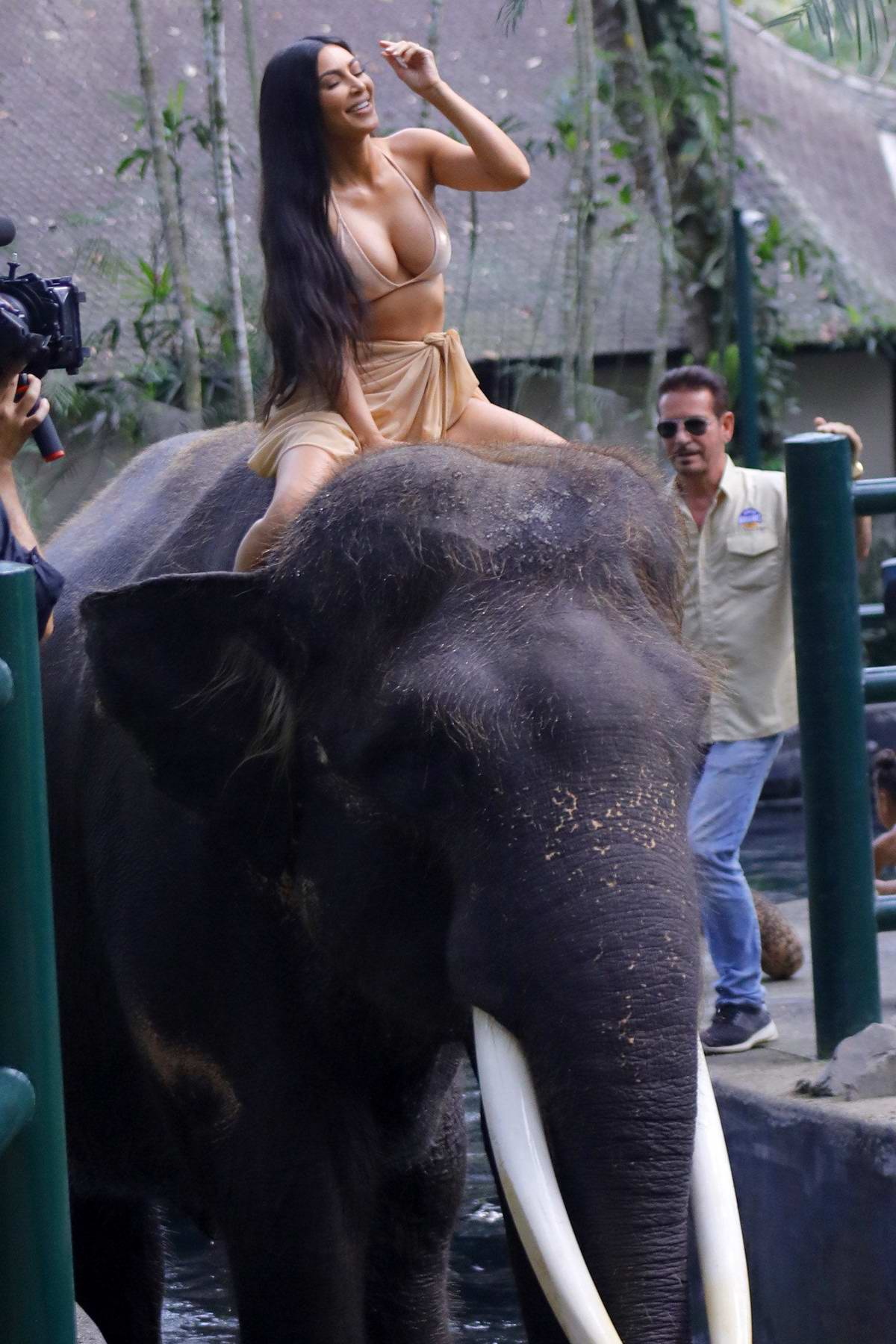 Kim Kardashian seen riding on an elephant while on vacation in Bali, Indonesia