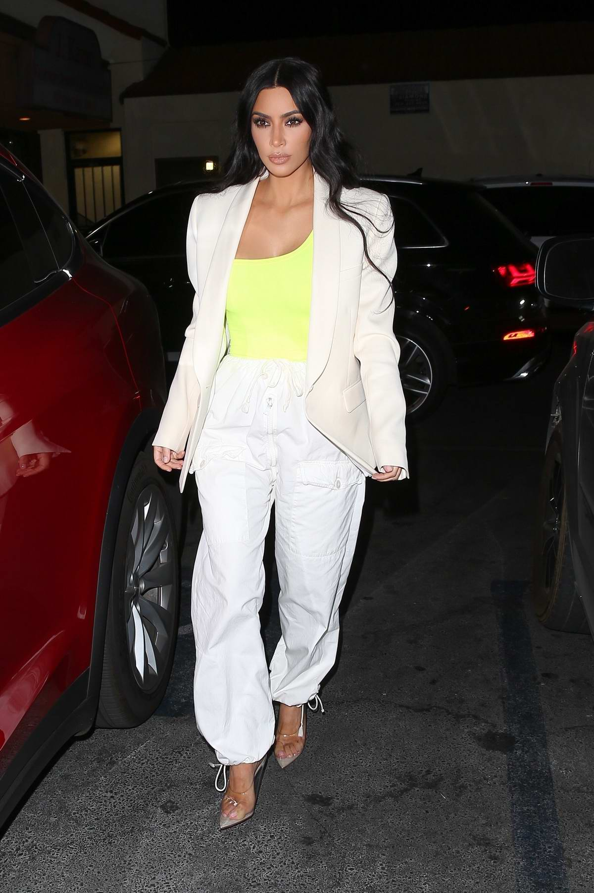 Kim Kardashian spotted wearing a yellow top with cream blazer and white pants during a night out in Hollywood, Los Angeles