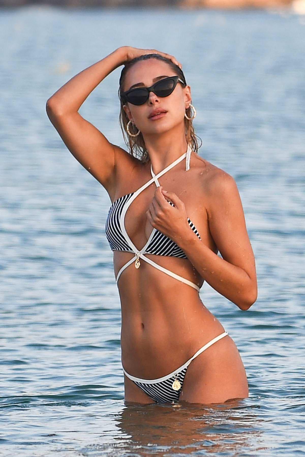 Kimberley Garner rocks a striped bikini from her own 'Kimberley London' Collection as she hits the beach in Miami, Florida