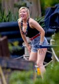 Kirsten Dunst spotted in a black deep cut tank top and denim shorts while filming scenes of her new AMC series 'On Becoming A God' in Central Florida