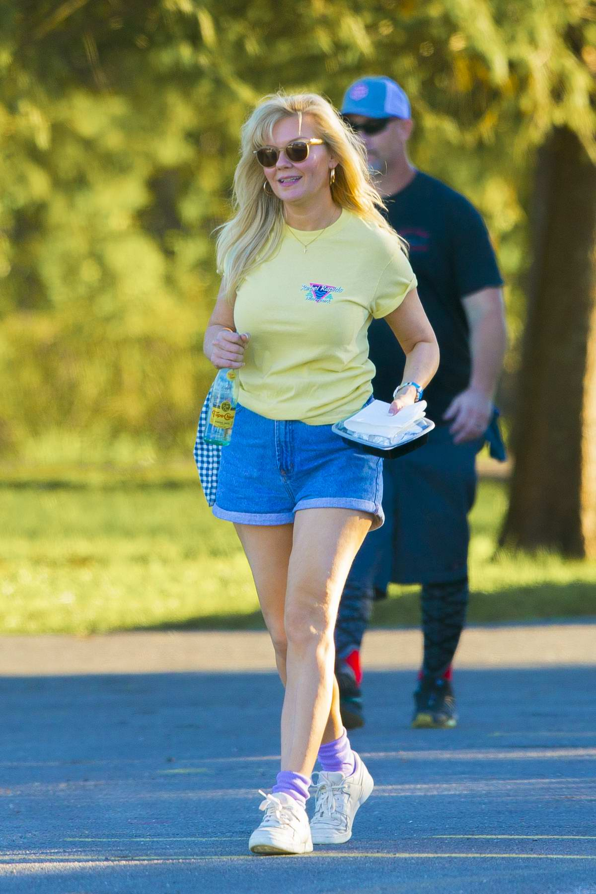 Kirsten Dunst spotted in a yellow tee and denim shorts while filming scenes of her new AMC Series 'On Becoming A God' in Central Florida