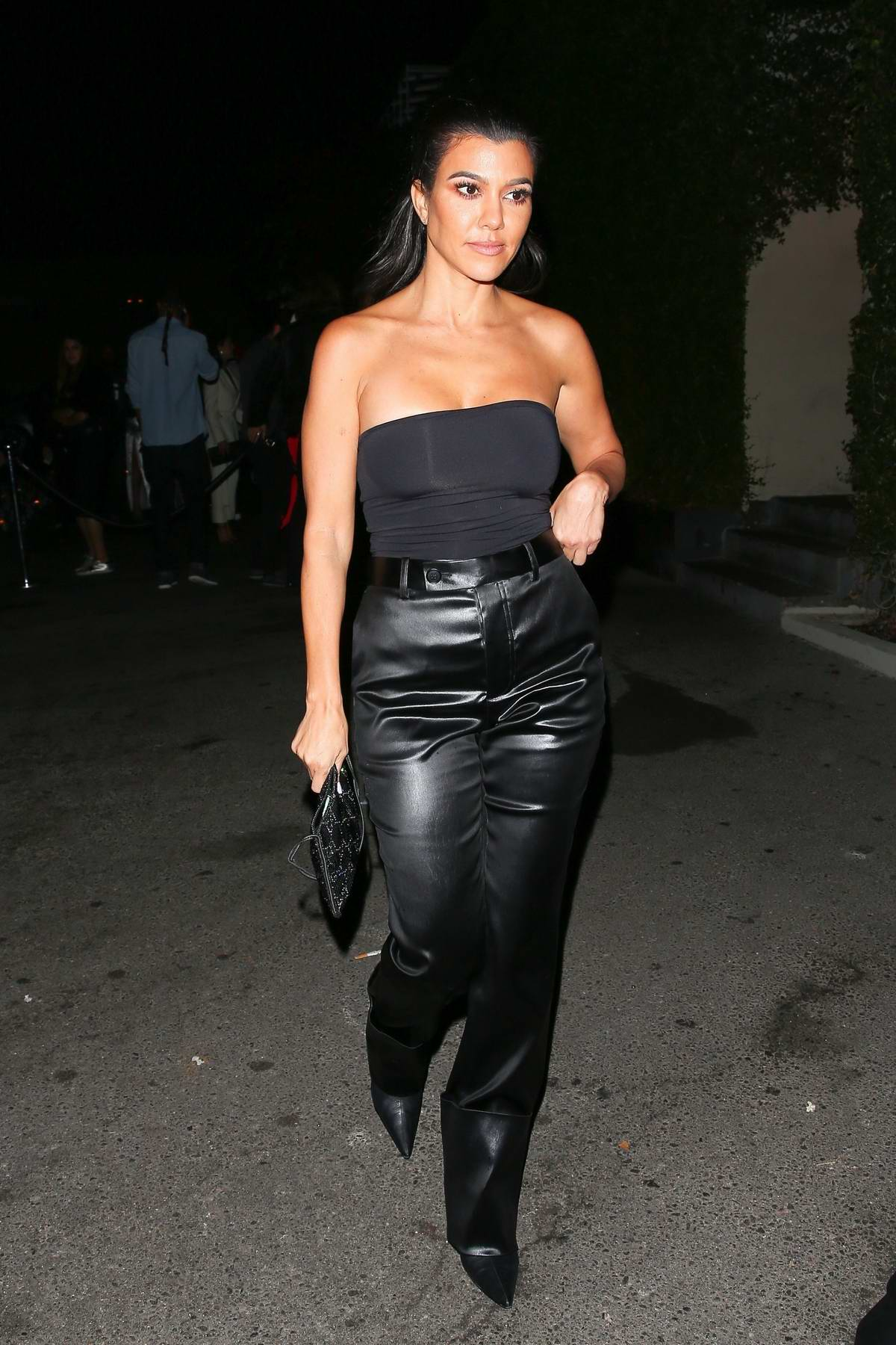 Kourtney Kardashian rocks a black tube top and leather pants at P Diddy's 49th birthday bash at Ysabel Restaurant in West Hollywood, Los Angeles