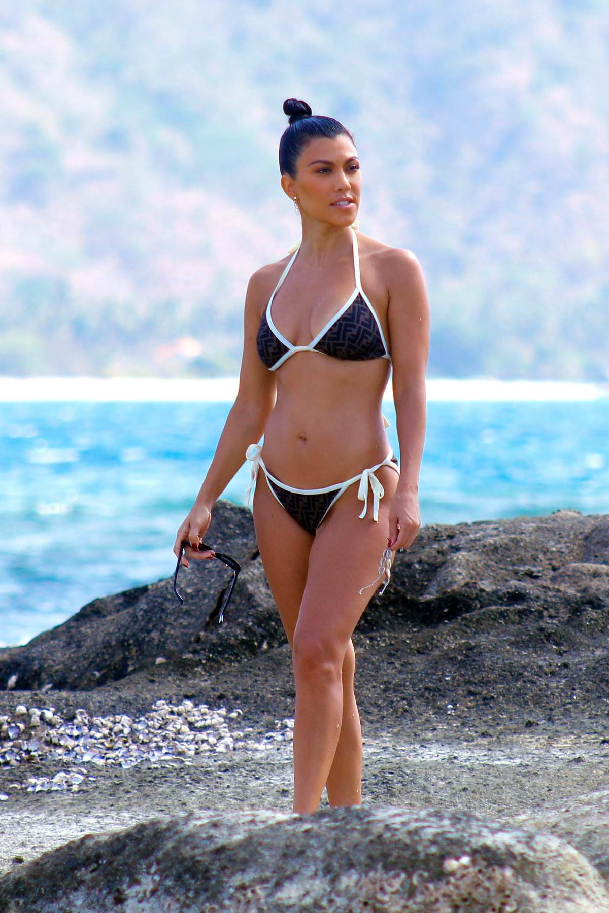 Kourtney Kardashian wears a Fendi bikini as she enjoys the beach in Bali, Indonesia