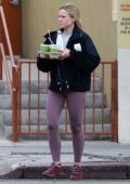 Kristen Bell rocks black jacket and purple leggings as she leaves the gym before stopping to get fresh juice in Los Feliz, California