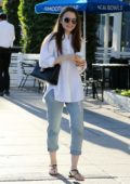 Lily Collins grabs a smoothie following a trip to the nail salon in Los Angeles