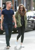 Lily Collins is all smiles while out shopping with Johnny Harper in Beverly Hills, Los Angeles