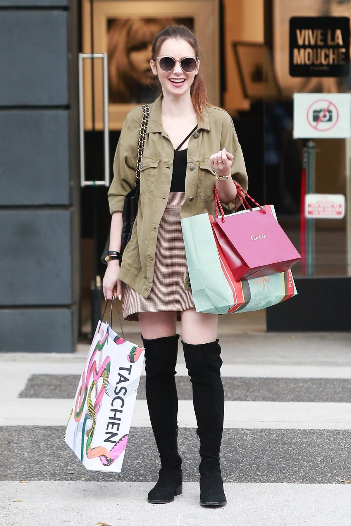 Lily Collins looks cute as she smiles for the camera while out for some shopping in Beverly Hills, Los Angeles