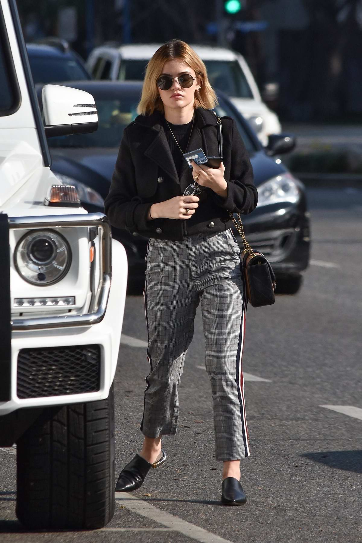 Lucy Hale looks cute in a black jacket and grey plaid trousers as she makes a coffee run to Starbucks in Studio City, Los Angeles