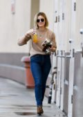 Lucy Hale seen in a beige sweater, jeans and leopard print boots as she steps out for fresh juice and snacks in Los Angeles