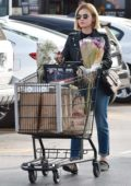 Lucy Hale seen shopping for groceries and flowers with a friend at Ralph's in Studio City, Los Angeles