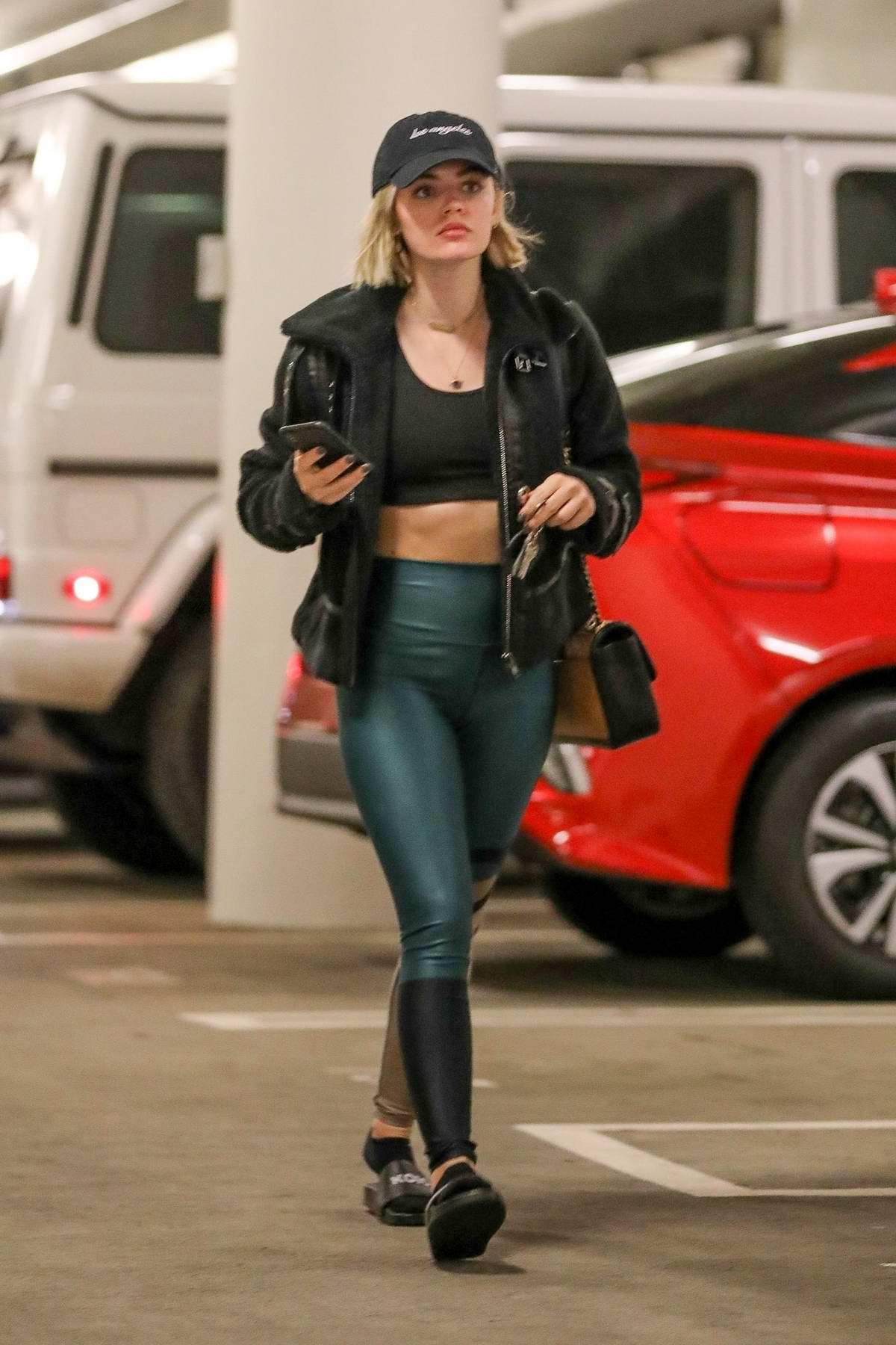 Lucy Hale shows off her toned abs as she leaves the gym after a workout on Thanksgiving Day in Los Angeles