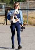 Lucy Hale wears a denim jacket with her blue activewear as she enjoys her morning with her pup at a dog park in Los Angeles