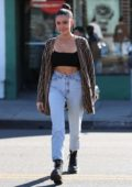 Madison Beer wears a Fendi cardigan with a crop top and jeans while out shopping at Necromance in West Hollywood, Los Angeles