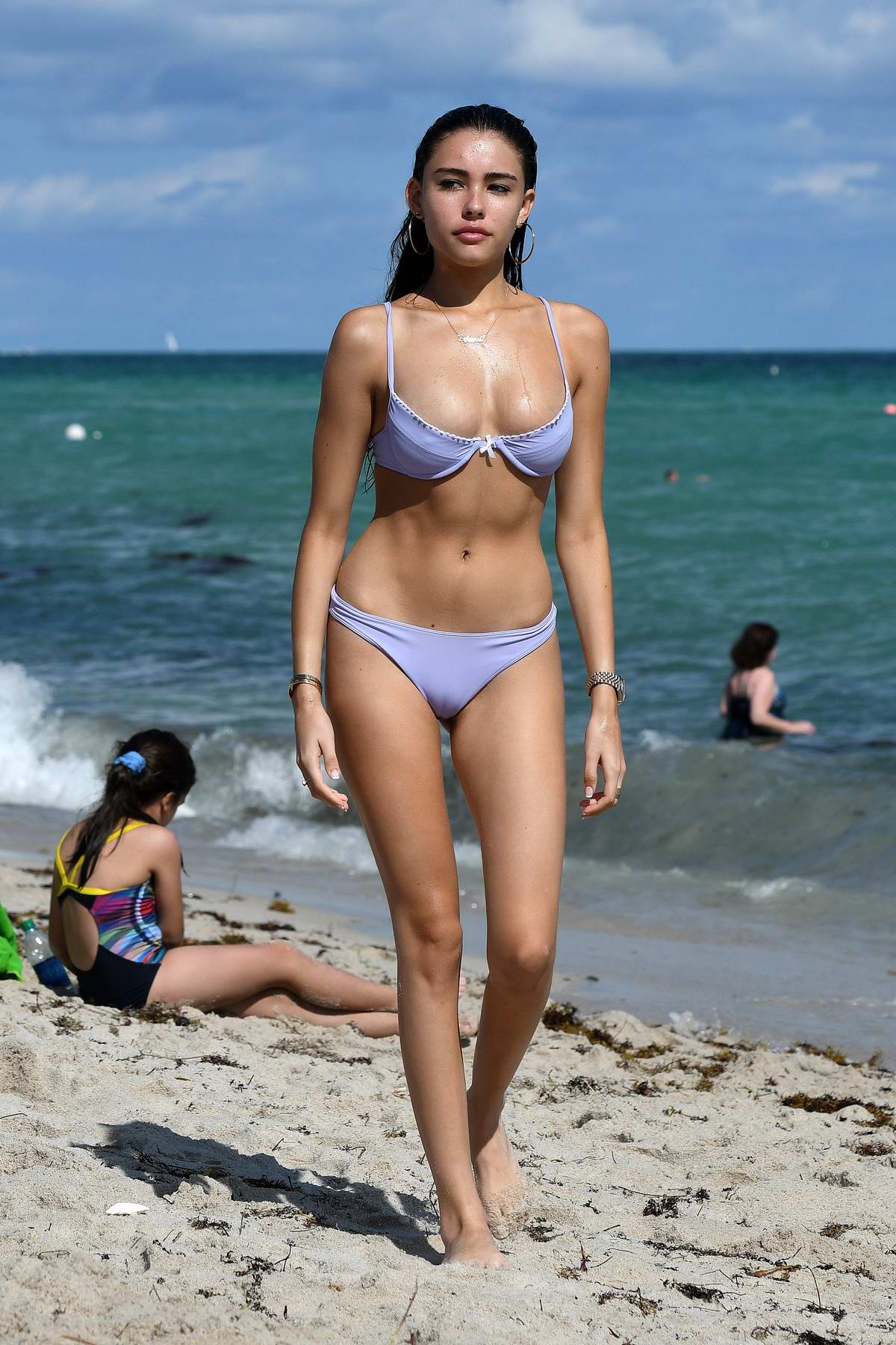 Madison Beer wears a purple bikini as she enjoys another day at the beach in Miami, Florida