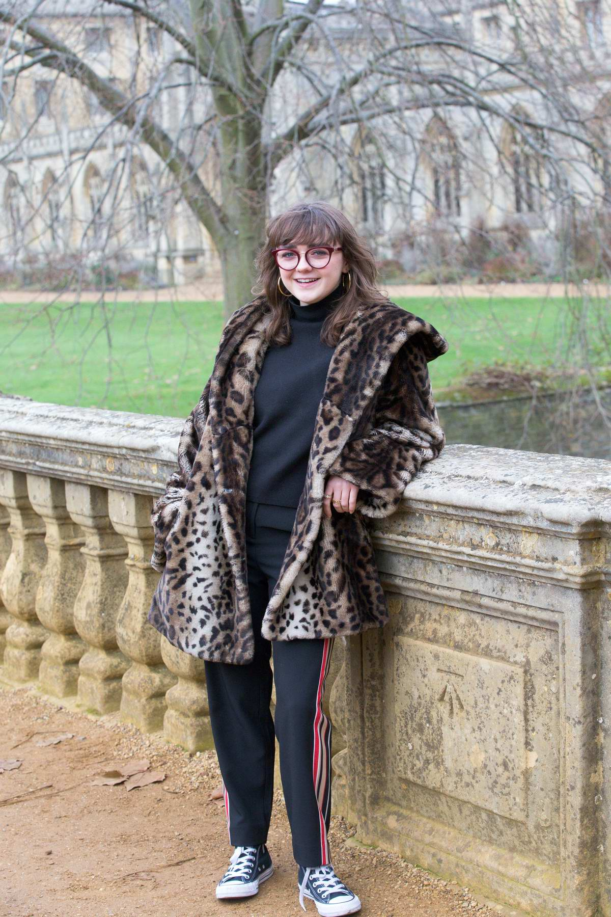 Maisie Williams spotted in a leopard print coat while visiting St. John's College in Cambridge University, UK
